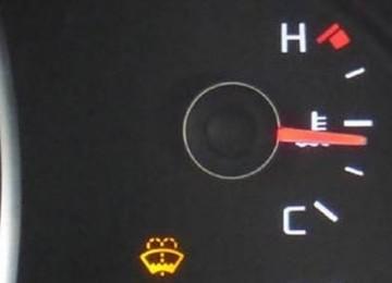 Где находится датчик температуры Киа Рио